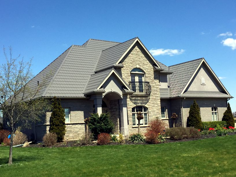 Marvelous The Lovely Fieldstone Of This Ontario Home Is Complemented By A Scalloped  Katola Metal Tile In
